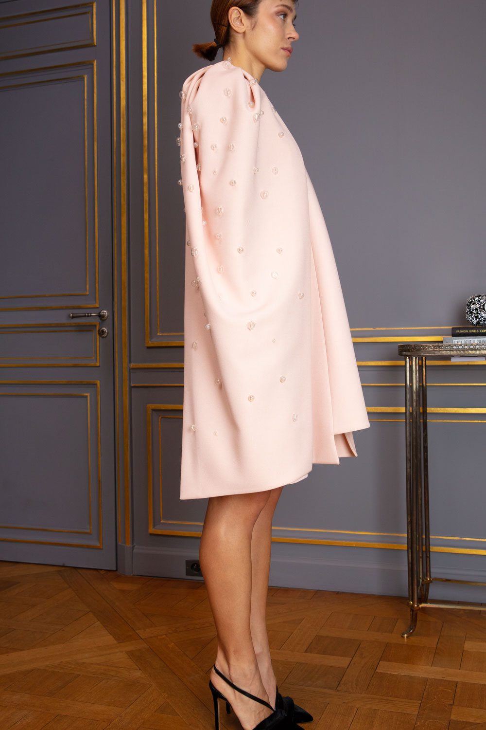 Pale shell pink trapeze dress with detachable demi-cape
