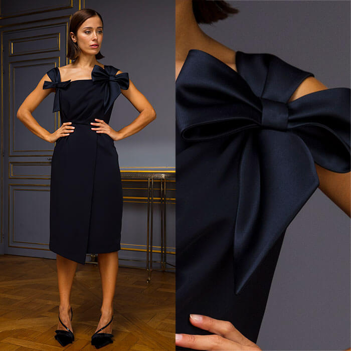 Midnight blue wraparound dress with bow sleeves