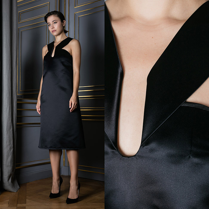 Black cocktail dress with unique button closure