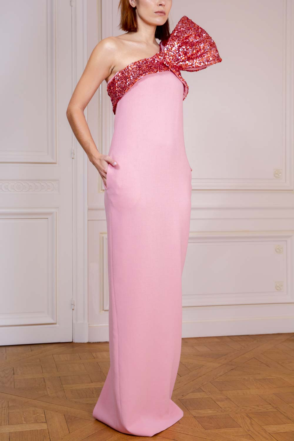Candy pink column evening gown with sparkling sequin bow